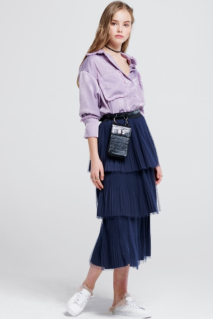 With lilac shirt, black mini bag and white sneakers
