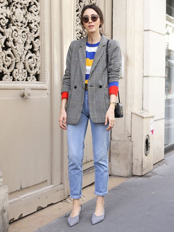 blue cuffed jeans, a colorful printed tee, a grey plaid blazer and printed shoes