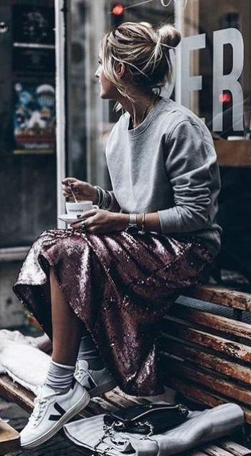 a grey plain sweatshirt, a pink sequin midi skirt and white trainers for an eclectic look