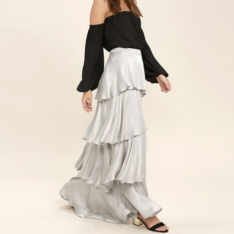 With black off the shoulder shirt and black sandals