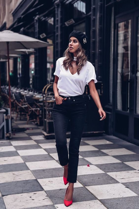 a white tee, black raw edge denim, red shoes and a black Chanel beret