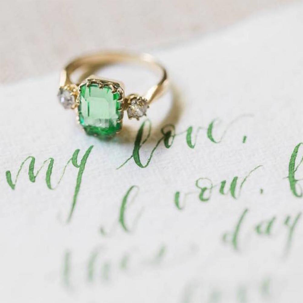 light green emerald cut engagement ring