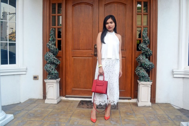 With white blouse, red pumps and red leather bag