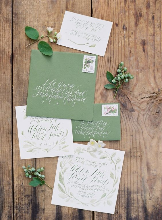 chic green and white wedding invitation suite with calligraphy and watercolro floral patterns
