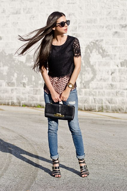 With jeans, black shoes, black bag and polka dot shirt