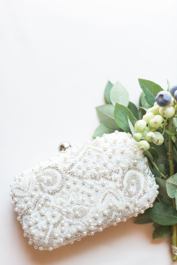 a gorgeous embellished sequin, beads and pearls wedding clutch is a masterpiece to complete your look