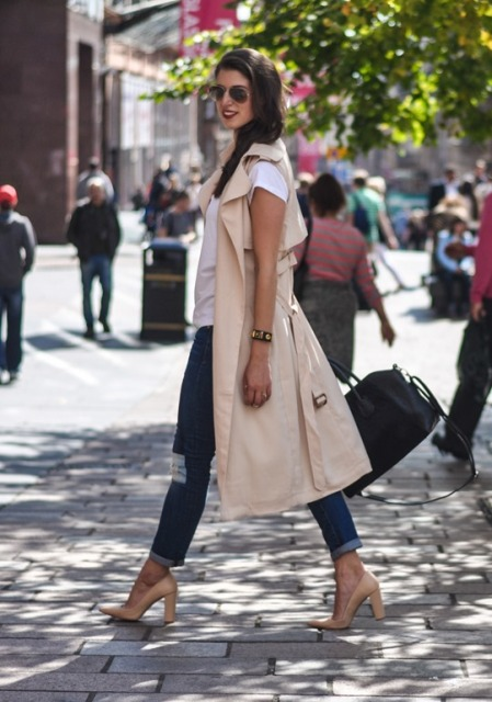 With white t-shirt, jeans, beige pumps and bag