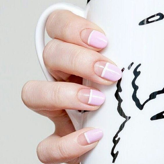 half negative space, half light pink nails with white stripes for a romantic person
