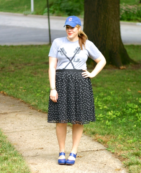 With t-shirt, polka dot skirt and blue shoes