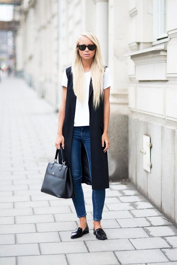 blue skinnies, a white tee, black long vest and black flats for a business casual look