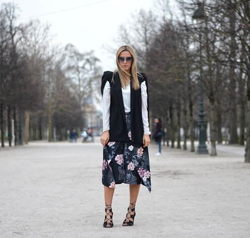 With white shirt, black vest and black lace up shoes