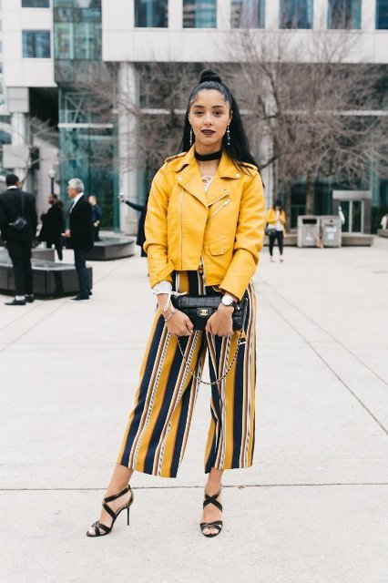With yellow jacket, black high heels and black clutch