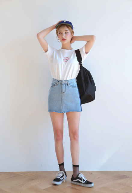 With white t-shirt, denim mini skirt, black bag and cap