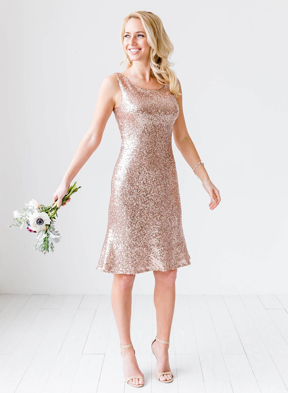 short rose gold sequined bridesmaid dress