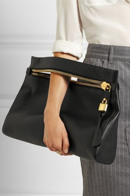 a medium-sized black leather clutch with a zip and a bag tag will fit many occasions