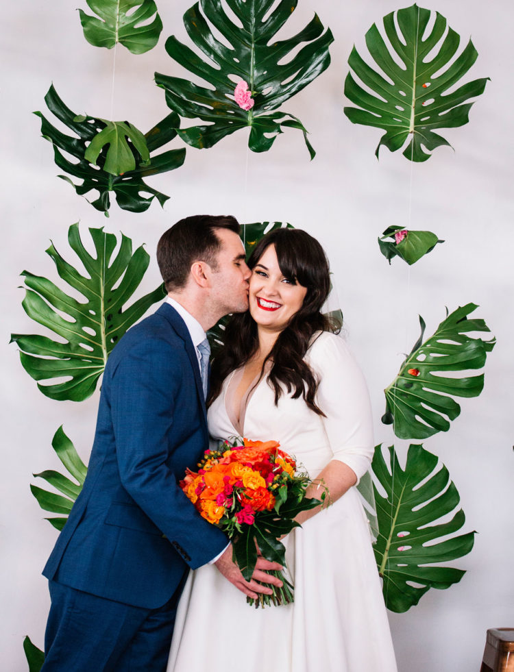 This couple chose an unusual wedding theme for an urban wedding a tropical oasis in NYC