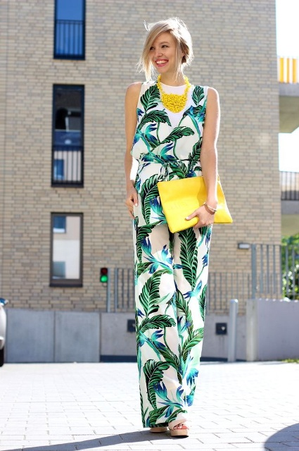 With white top, yellow necklace, yellow clutch and shoes