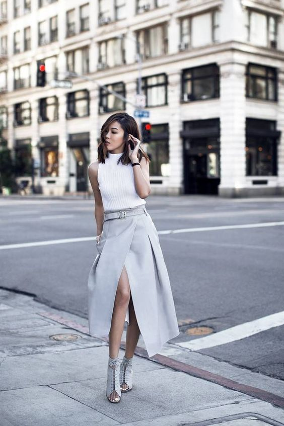 a white turtleneck without sleeves, a dove grey midi wrap skirt and matching lacing up mulles