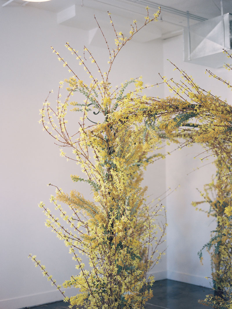 yellow natural flowers wedding arch