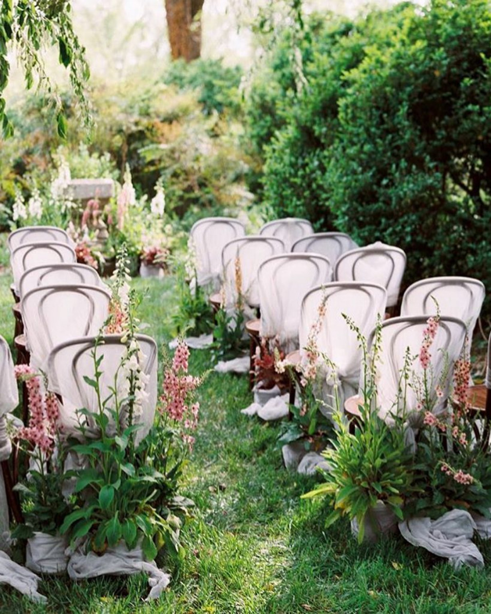 gauzy chair covers and oversized aisle flowers