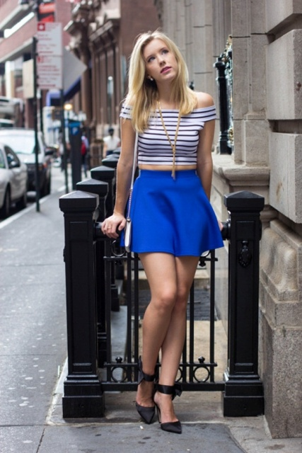 With cobalt blue mini skirt, high heels and bag