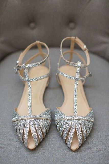 shiny silver flats with straps on top are chic and bold