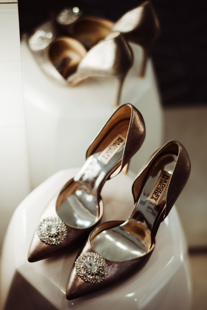 The bride was wearing metallic wedding shoes with heavy embellishments