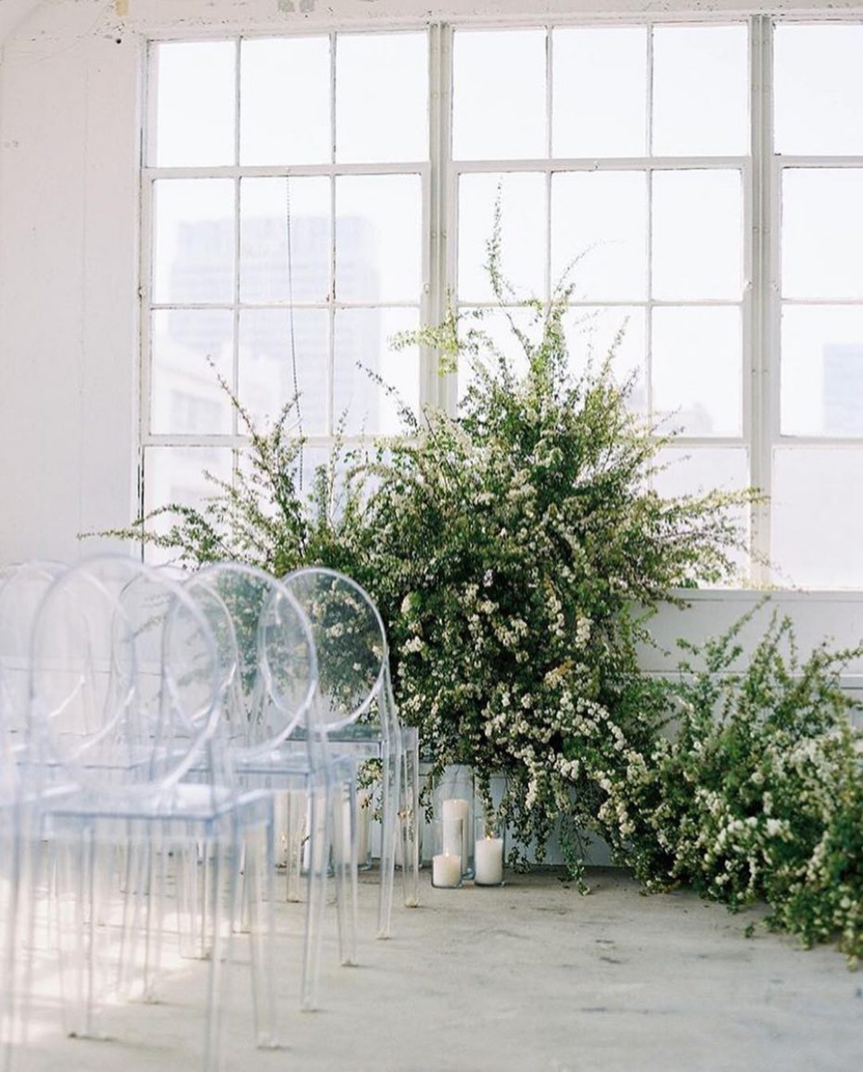 climbing wedding flower ceremony backdrop greenery and white