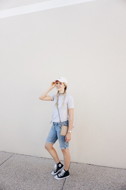 With t-shirt, cap, small bag and sneakers