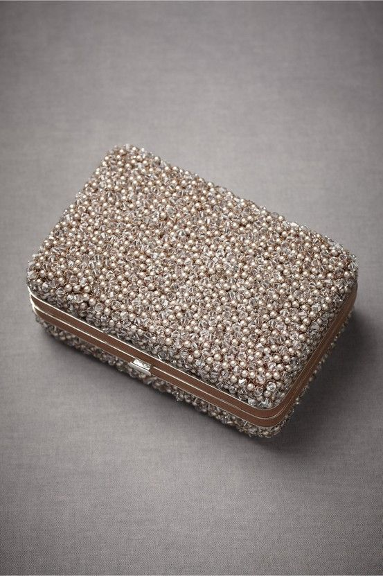 a gorgeous rhinestone and pearl box clutch is a super bold piece to make a stylish statement