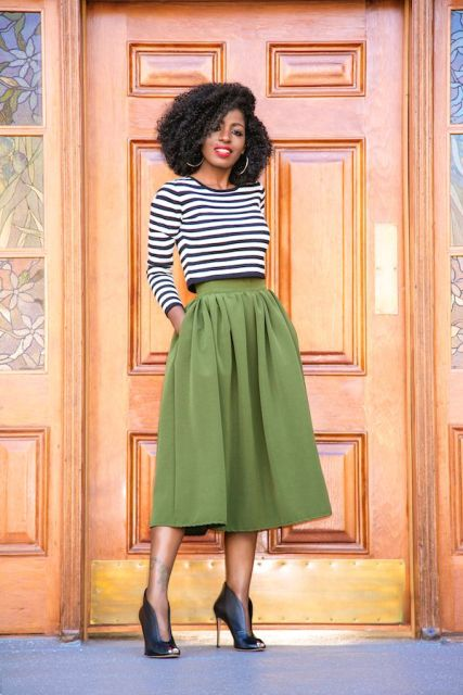 With green midi skirt and ankle boots