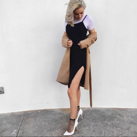 With black dress, camel trench coat and white pumps