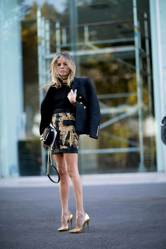 metallic shoes, a printed black and gold mini, a black tee and a jacket for a refined look