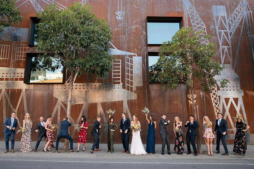fun bridal party pose in the city