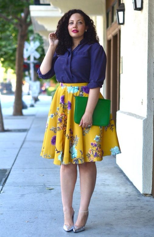 a purple shirt, a bold yellow floral skirt, silver shoes and a green clutch for spring