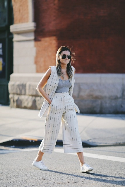 With gray top, striped vest and white sneakers