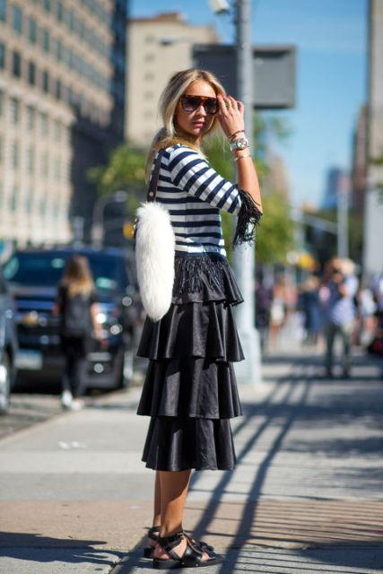 With striped shirt, flat sandals and sunglasses