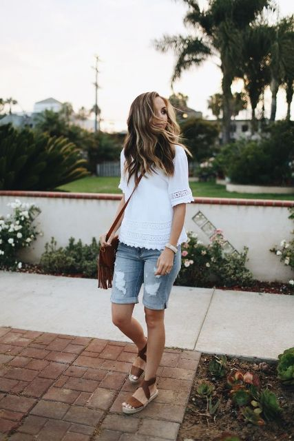 With white blouse, brown sandals and fringe bag