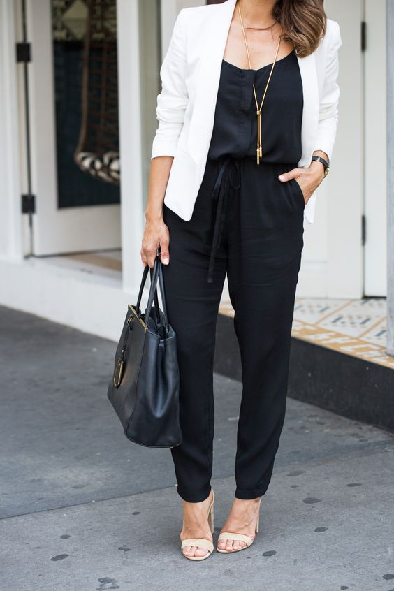 a relaxed black jumpsuit, a white jacket, blush shoes and a black bag