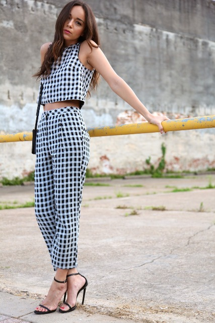 With checked trousers, black sandals and black small bag