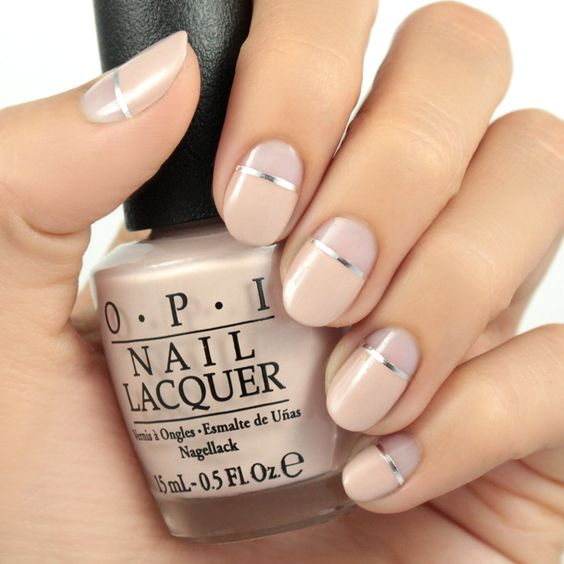 nude plus silver stripes negative space manicure for a bold modern look