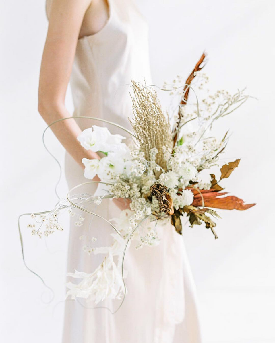 dried foliage wild and unruly bridal bouquet