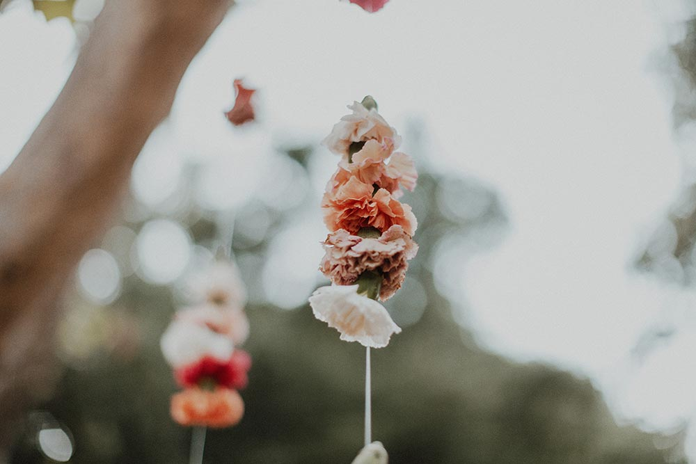 whimsical garden wedding reception suspended flowers