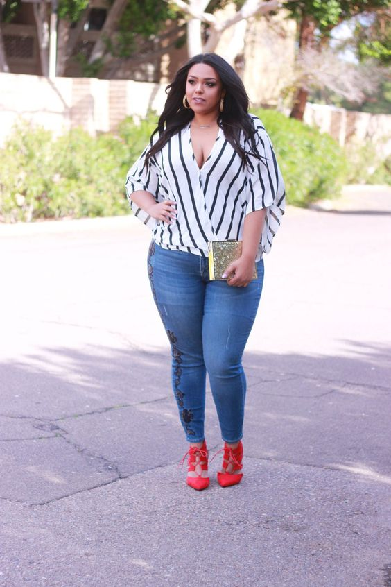 blue embellished skinnies, a striped blouse with a deep V-neck and red strappy shoes