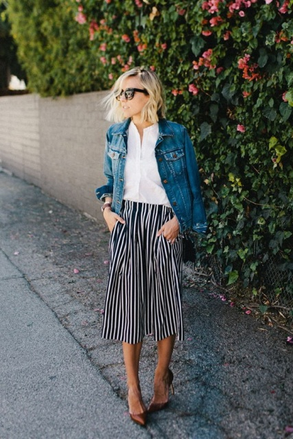 With white button down shirt, denim jacket and bronze pumps