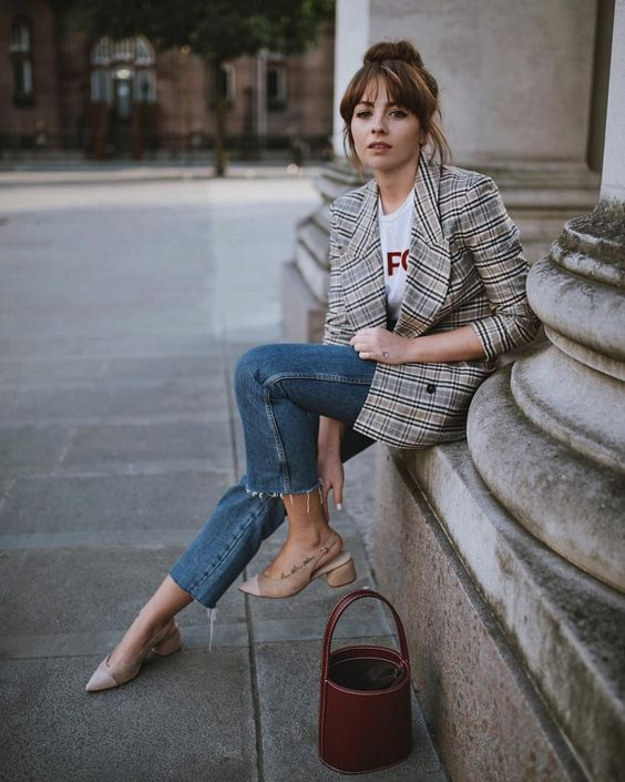 a grey plaid blazer, a printed tee, cropped blue jeans, nude shoes and a burgundy bag