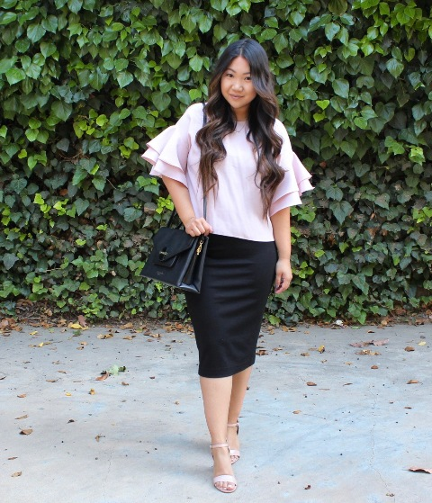 With black pencil skirt, beige sandals and black bag