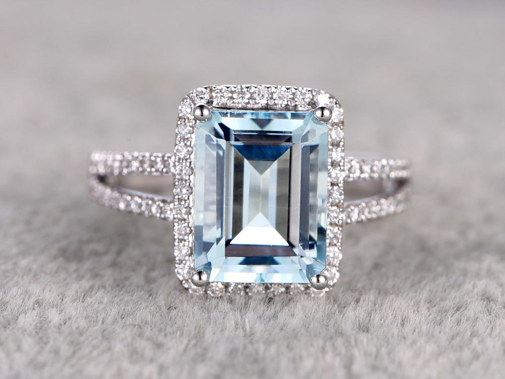 blue emerald cut engagement ring