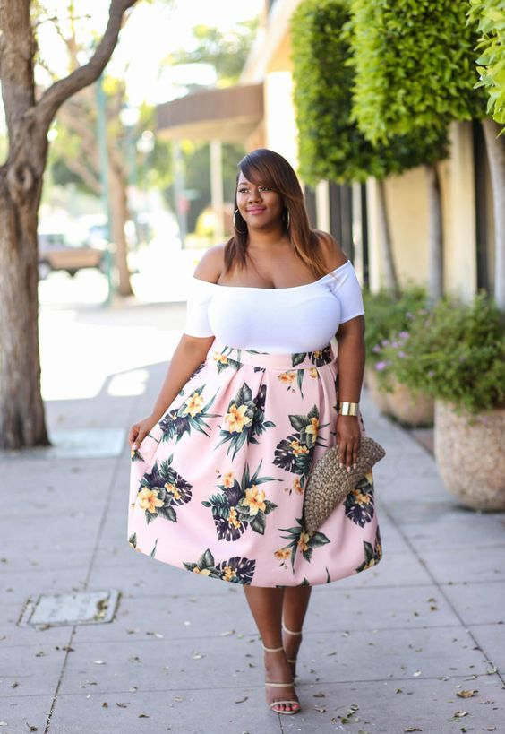 a white off the shoulder top, a pink full floral skirt, strappy heels and a wicker clutch