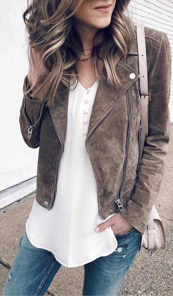 a white shirt with buttons, blue skinnies and a brown suede jacket